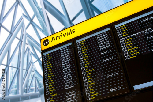 Photo  Check in, Airport Departure & Arrival information board sign