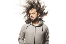 Young Man With The Beard And The Wind In The Hair On White