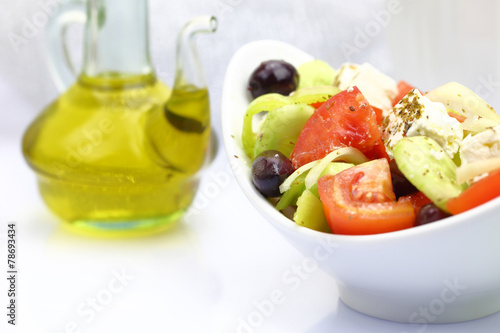 Fototapety, obrazy: Bowl with fresh salad and olive oil on tabletop