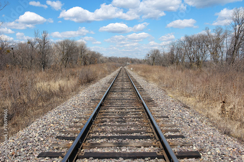 Railway to horizon and clouds on the sky background.