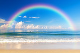 Fototapeta Rainbow - Beautiful sea with a rainbow in the sky