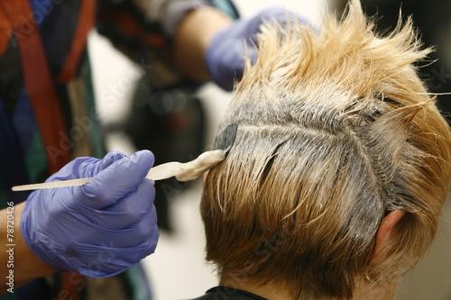 Obraz na plátně  Woman gets new hair color at the salon