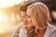 Leinwanddruck Bild - pretty girl cuddling with boyfriend on beach at santa monica