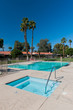 Two swimming pools with palm trees and chair