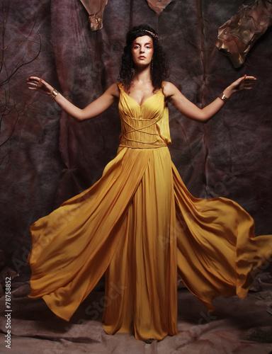 Carta da parati brunette woman wearing yellow evening dress