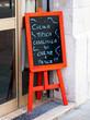 An advertising blackboard outside an italian restaurant