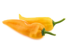 Two Fresh Yellow Sweet Peppers (capsicum) On A White Background