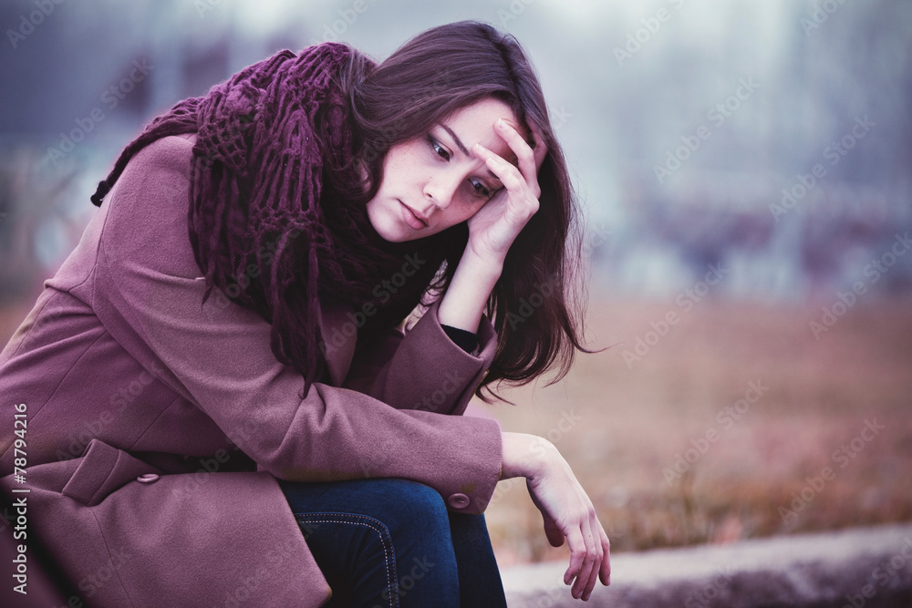 Fototapety, obrazy: Sad Young Woman Sitting Outdoors