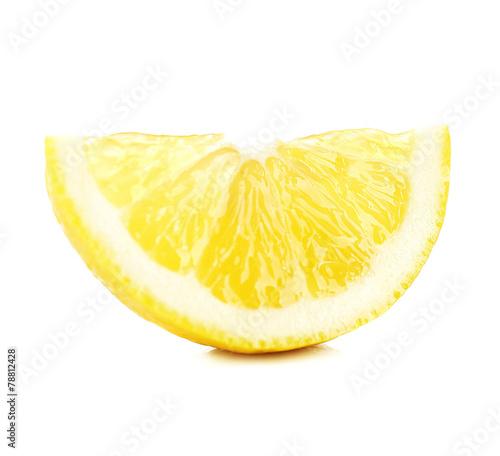 Juicy slice of lemon isolated on white