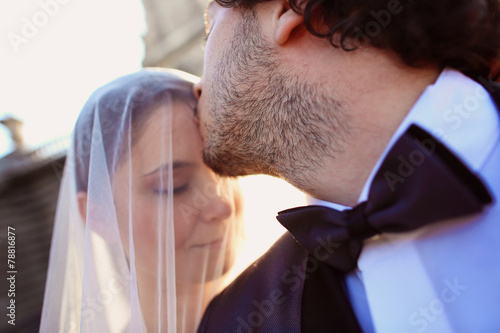 Fototapety, obrazy: Close up of a bride and groom in the sunlight