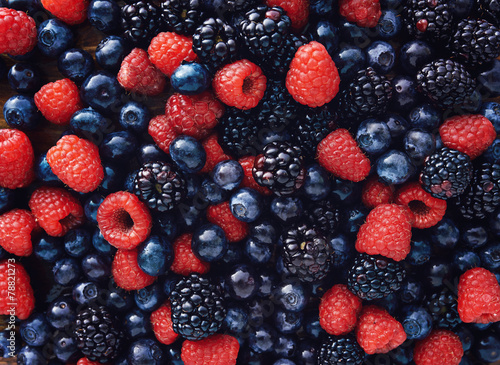 Fototapeta blueberies, raspberries and black berries shot top down obraz