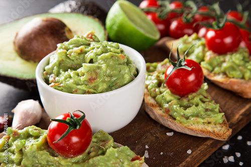 Fotografie, Obraz  Guacamole with bread and avocado