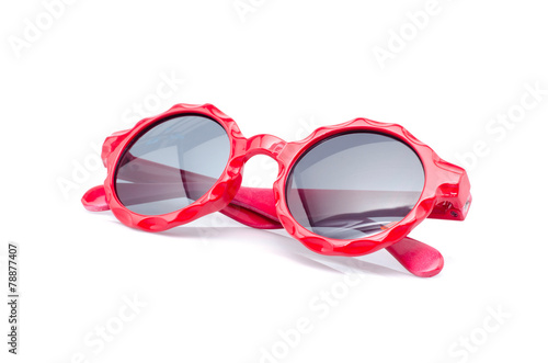 Baby's red sunglasses isolated on white