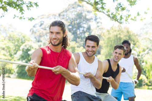 Fotografie, Obraz  Fitness group playing tug of war