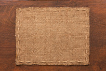 Frame Of Burlap, Lies On A Background Of Wood