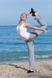 Female fitness on seashore