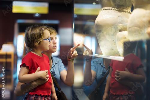 Valokuvatapetti Woman and child  in historical museum