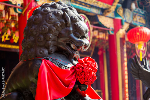 Lion statue in Chinese temple Poster
