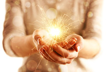 Hands With Sparkler Light Isolated On White