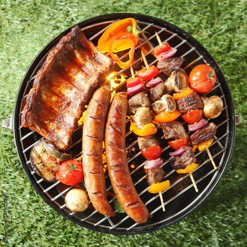 Foto op Plexiglas Grill / Barbecue Tasty assortment of meat on a summer barbecue