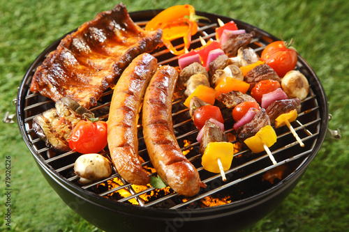 Photo Stands Grill / Barbecue Assorted grilled meat on a summer barbecue