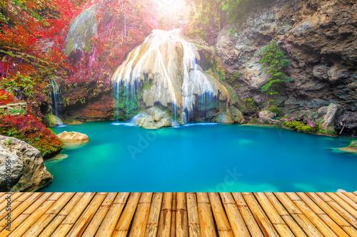 Wall Murals Waterfalls wonderful waterfall in thailand with bamboor floor