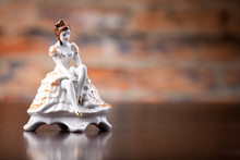 Small Porcelain  Statuette Of A Woman