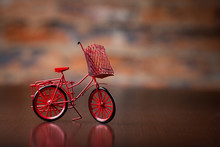 Close-up Of Miniature Hand Made Toy Bicycle On Brick  Background