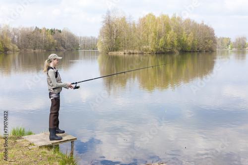 Printed kitchen splashbacks Fishing woman fishing on pier at pond