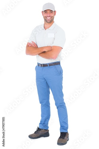 Fotomural  Portrait of confident handyman standing arms crossed