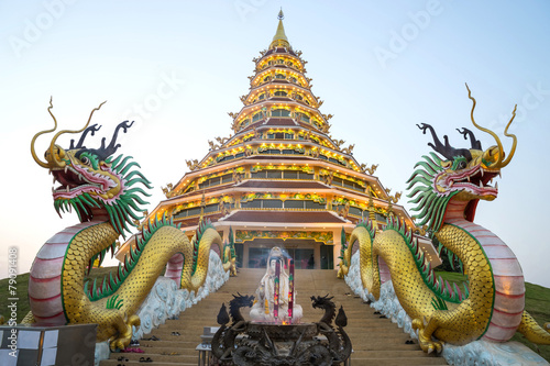 Wall Murals Place of worship Chinese style pagoda in Thai temple under twilight sky