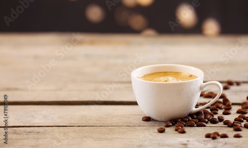 Wall Murals Cafe Cup of coffee on table on brown background