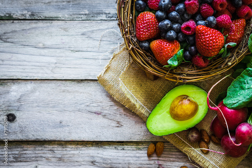 obraz dibond Fruits and vegetables on rustic background