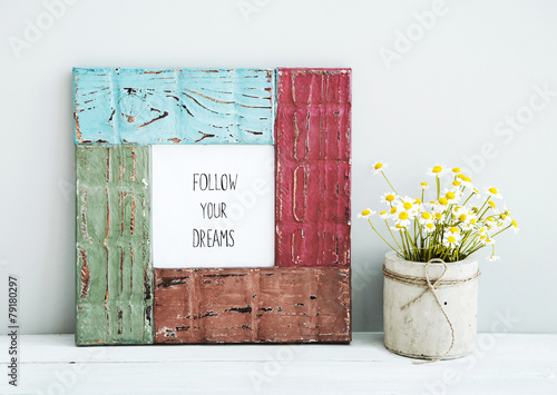 Photo  colored  hipster frame with chamomile FOLLOW YOUR DREAMS