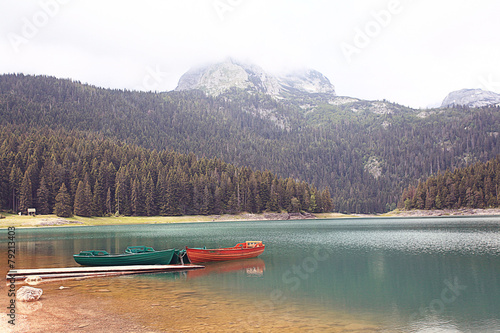 Spoed Foto op Canvas Lavendel wooden boat on a mountain lake landscape mountain sky