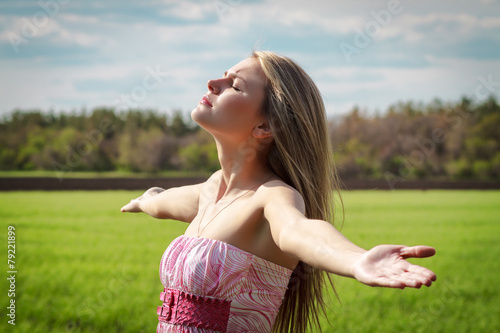 Beautiful young woman enjoying unity with nature - Buy this
