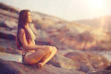 Woman Meditating On The Sea Sun Beach