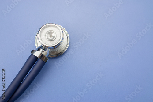 Fototapeta Stethoscope on a blue background obraz na płótnie