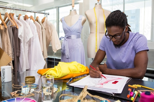 Fotografie, Tablou Attractive male fashion designer sketching