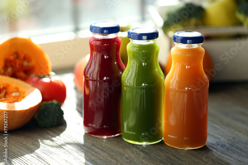 Bottles of juice with fruits and vegetables