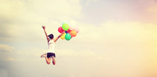 Young Asian Woman Jumping With Colored Balloons