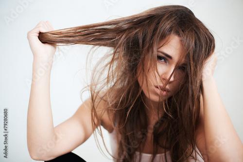 Fototapeta  The woman with a wild unhealthy hair