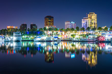 Buildings And Boats Reflecting In The Harbor At Night, Seen From