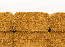 Close-up Of Yellow Stacked Hay...