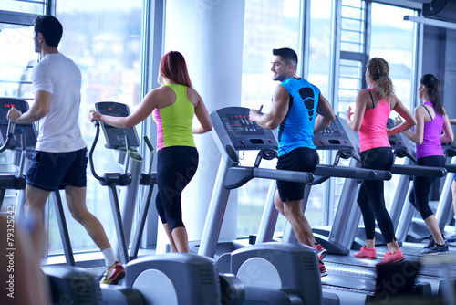 Group of people running on treadmills #79325242