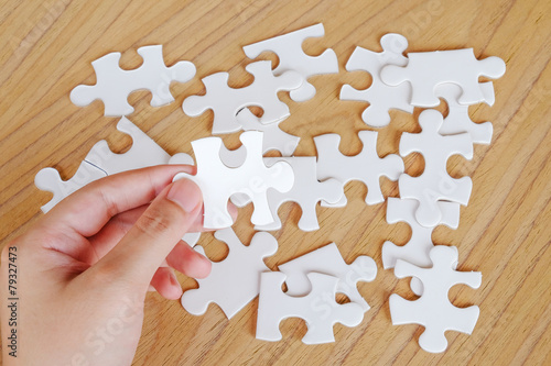 Fototapety, obrazy: Jigsaw puzzle in hand, business background