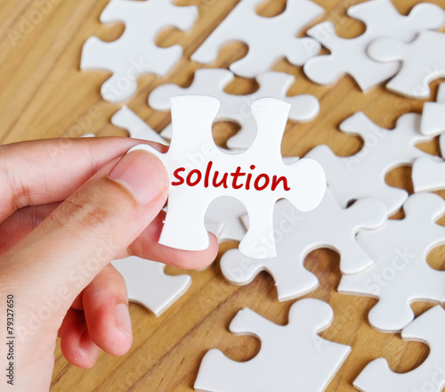 Fototapety, obrazy: Solution word on jigsaw puzzle in hand, business background