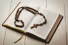 Open Bible And Wooden Rosary B...
