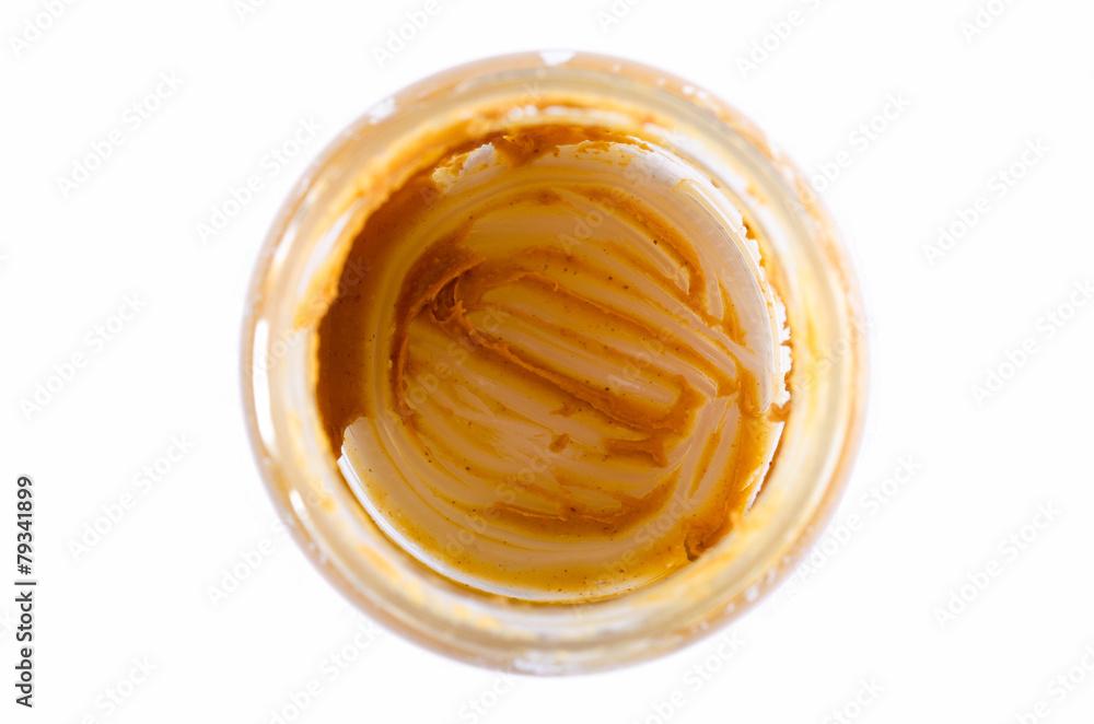 Fototapeta Dirty jar of peanut butter - obraz na płótnie