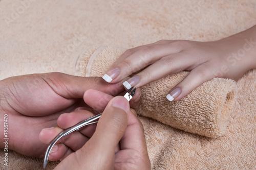 Foto op Canvas Pedicure Manicure. Trimming the cuticle